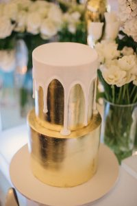 gold-metallic-wedding-cake-with-dripping-white-icing